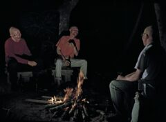 Three albinos telling jokes at the fire