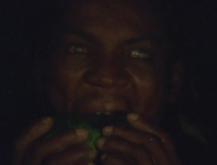 Solar, the blindman eating a papaya